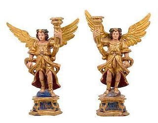 * A Pair of Italian Painted and Gilt Figural Candlesticks Height 28 1/2 inches.