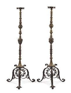A Pair of Neoclassical Brass Torcheres Height 59 3/4 inches.