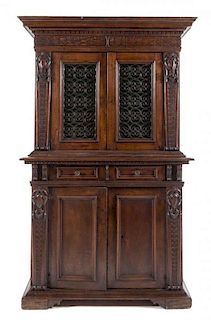 An Italian Renaissance Style Walnut Cabinet Height 79 1/2 x width 48 1/2 x depth 19 7/8 inches.