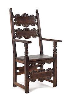 * An Italian Baroque Walnut Armchair Height 50 1/2 inches.