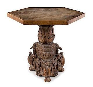 * An Italian Baroque Carved Walnut Center Table Height 32 x width 34 1/8 x depth 34 1/8 inches.