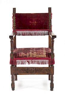 * An Italian Baroque Walnut Armchair Height 44 1/2 inches.
