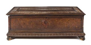 * An Italian Marquetry Cassone Height 25 x width 67 1/4 x depth 24 inches.