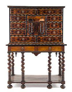* An Italian Bone Inlaid Burl Walnut Cabinet on Stand Height 66 7/8 x width 48 3/8 x depth 21 1/8 inches.