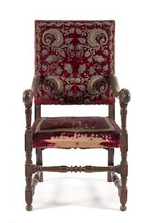 * A Spanish Baroque Walnut Armchair Height 43 1/4 inches.