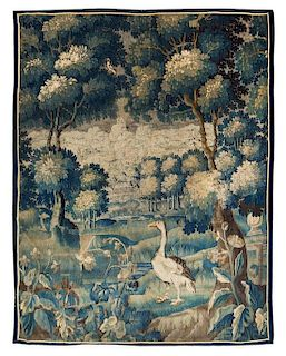 * A Flemish Wool Verdure Tapestry 7 feet x 5 feet 9 inches.