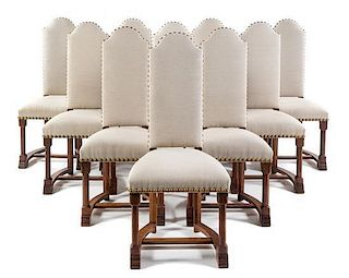 A Set of Fourteen Continental Oak Dining Chairs Height 45 3/4 inches.