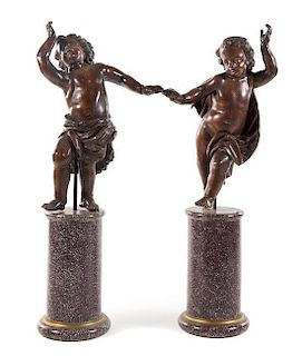 A Pair of Italian Carved Oak Figures Height of taller 54 1/4 inches.