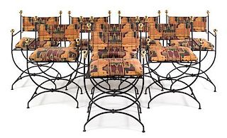 A Set of Eight Wrought Iron Curule Armchairs Height 36 inches.