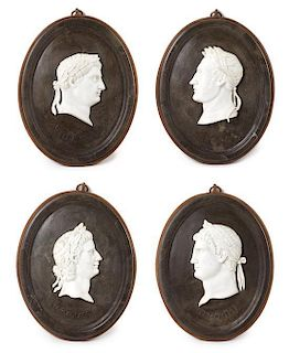 A Set of Four Marble Profile Plaques Height 22 1/2 x width 16 1/2 inches.