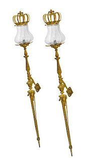 A Pair of Continental Bronze Sconces Height 72 1/2 inches.