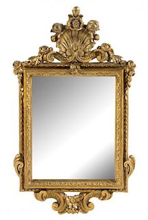 A Continental Giltwood Mirror Height 49 1/2 x width 28 inches.