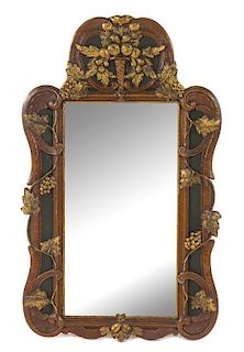 A Continental Painted and Gilt Mirror Height 39 x width 24 1/2 inches.