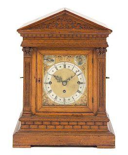 A German Oak Musical Mantel Clock Height 17 7/8 inches.