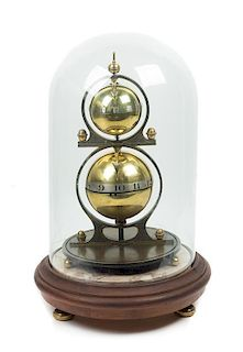 A Gustave Jeager Double Globe Patent Clock Height overall 17 1/2 inches.