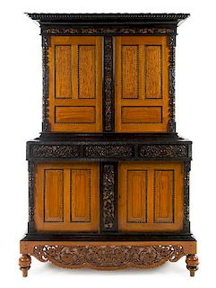 An Indo-Dutch Parcel Ebonized Satinwood Cabinet Height 84 1/4 x width 56 x depth 32 1/2 inches.