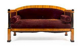 * A Biedermeier Parcel Ebonized Birch Sofa Height 39 x width 67 inches.