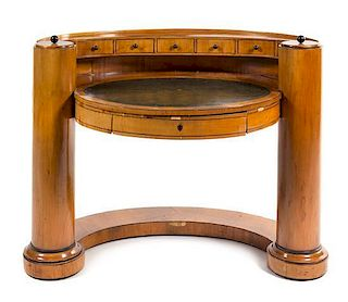 * A Biedermeier Fruitwood Writing Table Height 37 x width 46 inches.