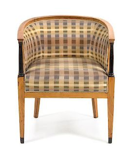 * A Biedermeier Parcel Ebonized Tub Chair Height 29 inches.