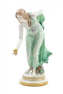 A Meissen Porcelain Figure Height 11 5/8 inches.