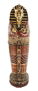 An Egyptian Style Painted Composition Sarcophagus Cabinet Height 74 1/2 inches.