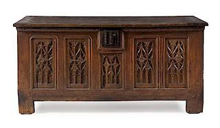 * A French Renaissance Iron Mounted Oak Chest Height 29 1/2 x width 61 7/8 x depth 25 1/2 inches.