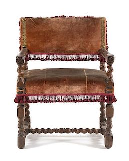 * A French Baroque Walnut Armchair Height 32 1/4 inches.