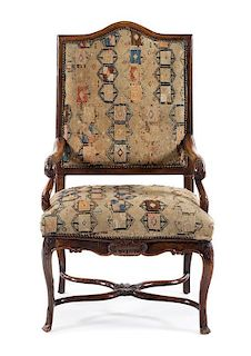 A Regence Walnut Open Armchair Height 48 1/2 inches.