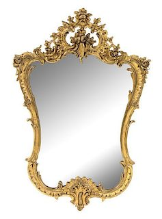 A Rococo Style Giltwood Mirror Height 35 1/2 x width 24 1/2 inches.