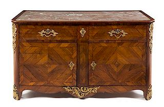 A Regence Style Gilt Bronze Mounted Kingwood Cabinet Height 33 x width 59 1/4 x depth 27 1/8 inches.