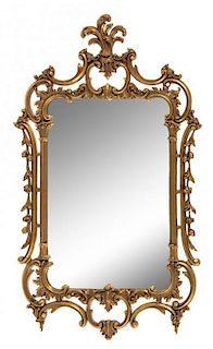A French Rococo Style Giltwood Mirror Height 49 x width 30 inches.