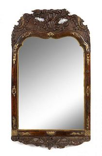 A Rococo Style Parcel Gilt Carved Mirror Height 32 1/4 x width 18 1/2 inches.