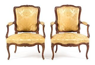 A Pair of Louis XV Style Walnut Fauteuils Height 36 inches.