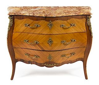A Louis XV Style Bookmatch Veneered Commode Height 35 x width 42 1/2 x depth 20 inches.