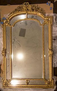 A Louis XVI Style Giltwood Pier Mirror Height 68 x width 40 1/2 inches.