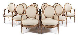 * A Set of Twelve Louis XVI Style Dining Chairs Height of tallest 38 1/2 inches.