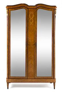 A Louis XVI Style Burlwood Marquetry Armoire Height 90 3/4 x width 52 1/2 x depth 20 1/4 inches.