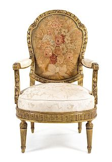 A Louis XVI Style Giltwood Fauteuil Height 46 inches.