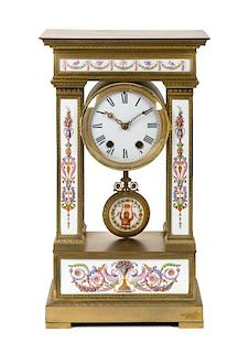A Louis XVI Style Porcelain Inset Gilt Bronze Mantel Clock Height 21 1/2 inches.