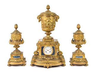A Louis XVI Style Lapis Lazuli Inset Gilt Bronze Clock Garniture Height of mantel clock 23 3/4 inches.