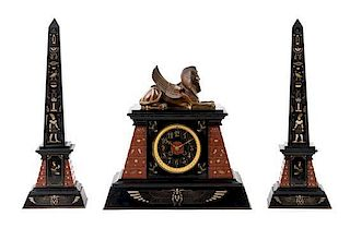 A French Egyptian Revival Three-Piece Clock Garniture Height of obelisk 20 1/4 inches.