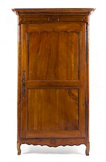 A Louis Philippe Walnut Armoire Height 79 1/8 x width 45 1/4 x depth 25 inches.