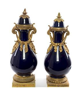 * A Pair of Sevres Style Gilt Bronze Mounted Porcelain Vases Height of taller 29 inches.