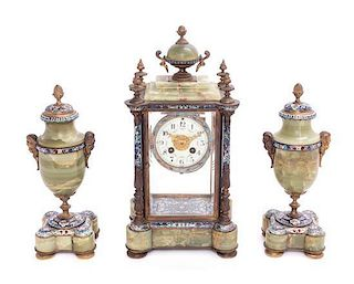 A French Gilt Bronze, Onyx and Champleve Clock Garniture Height of mantel clock 16 inches.