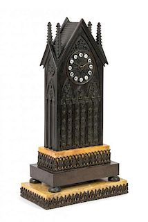 A French Gothic Revival Bronze and Sienna Marble Mantel Clock Height overall 23 1/2 inches.