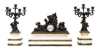 A French Bronze and Marble Three-Piece Clock Garniture Width of clock 22 inches.