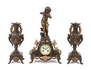 A French Bronze and Cast Metal Clock Garniture Height of mantel clock 18 3/4 inches.