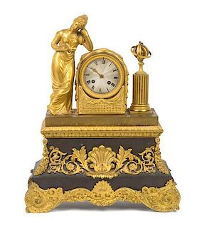 * A French Gilt and Patinated Metal Figural Mantel Clock Height 18 5/8 inches.