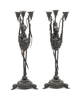 * A Pair of French Bronze Three-Light Candelabra Height 20 inches.