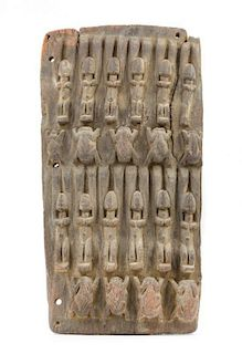 * A Dogon Wood Granary Door Height 21 x width 11 1/8 inches.